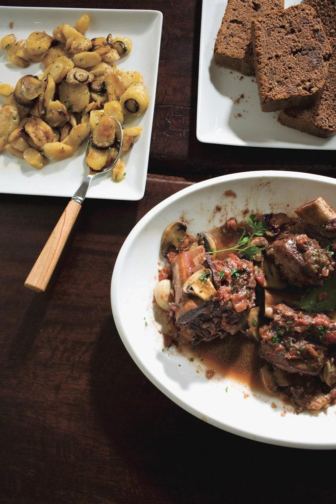 """The short ribs will simmer all day with fresh Italian parsley, garlic, onion, mushrooms, diced tomatoes, dry red wine, and kosher salt. Serve with crusty bread and you've got an amazing, hands-off dinner. <a href=""""https://www.epicurious.com/recipes/food/views/braised-short-ribs-350091?mbid=synd_yahoo_rss"""" rel=""""nofollow noopener"""" target=""""_blank"""" data-ylk=""""slk:See recipe."""" class=""""link rapid-noclick-resp"""">See recipe.</a>"""