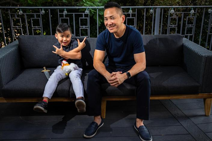 Viet Thanh Nguyen sits with his son, Ellison.