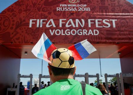 Soccer Football - FIFA World Cup - Group G - Tunisia v England - Volgograd, Russia - June 17, 2018 - A fan walks at fan fest zone. REUTERS/Gleb Garanich