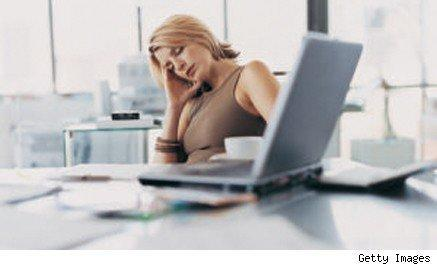 discouraged looking woman sitting at a laptop
