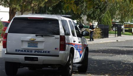 Sparks police secure the scene of a shooting on Woodhaven Lane in Sparks, Nevada October 21, 2013. REUTERS/Steve Timko/Reno Gazette-Journal