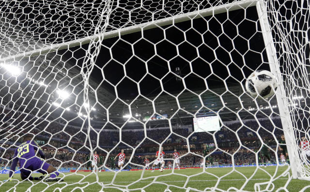 Croatia's Luka Modric scores his side's second goal from the penalty spot during the group D match between Croatia and Nigeria at the 2018 soccer World Cup in the Kaliningrad Stadium in Kaliningrad, Russia, Saturday, June 16, 2018. (AP Photo/Petr Josek)