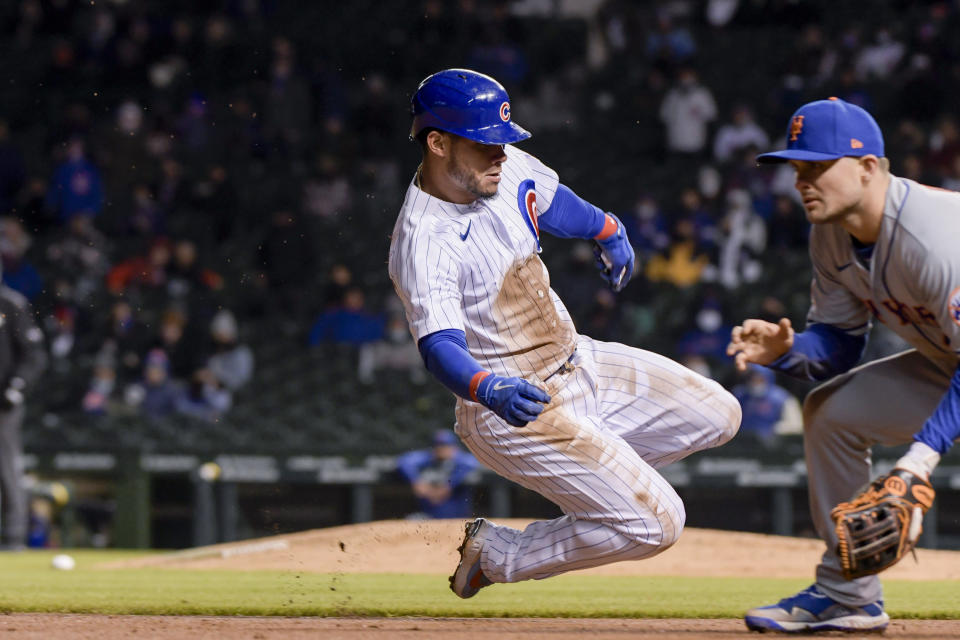 Chicago Cubs Willson Contreras (40) slides safely into third against the New York Mets during the fifth inning of a baseball game Wednesday, April 21, 2021, in Chicago. (AP Photo/Mark Black)