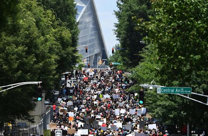 Protesters march through downtown Atlanta during rally to mark Juneteenth (AFP Photo/CHANDAN KHANNA)