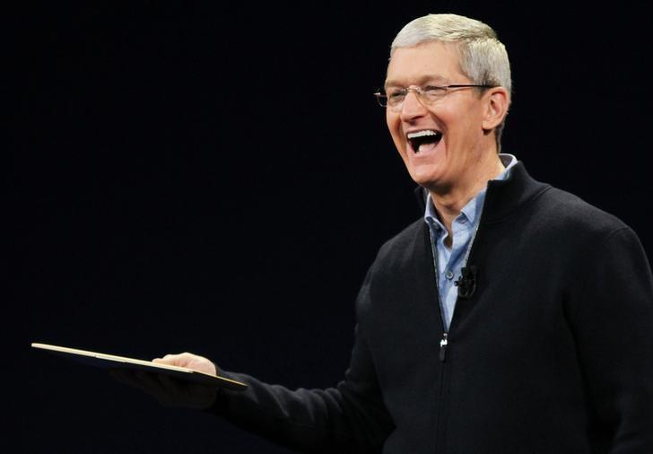 Apple CEO Tim Cook shows the new MacBook during an Apple event in San Francisco
