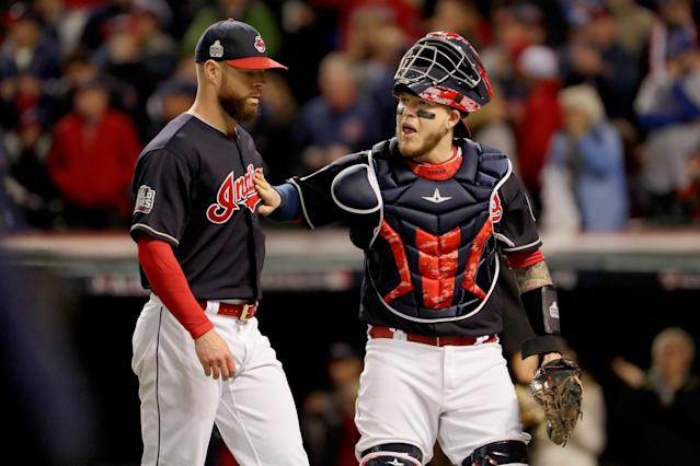 Roberto Perez (right) has helped guide the Indians' pitching staff through the postseason. (Getty)
