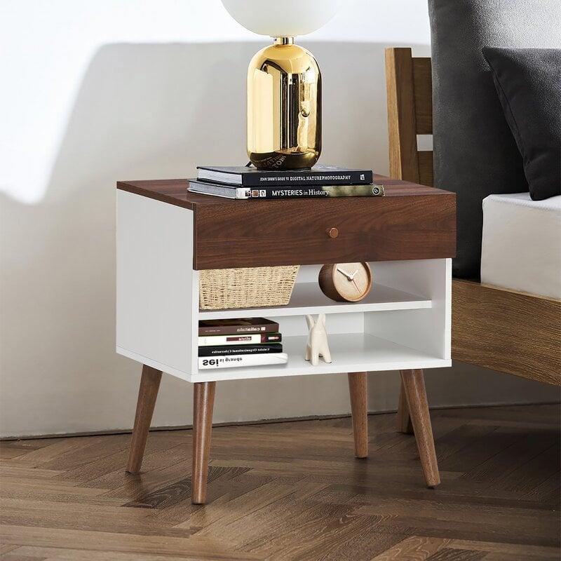 <p>Instead of a standard drawer, this <span>George Oliver Snowden Nightstand</span> ($138) has a fun twist, which definitely makes it stand out.</p>