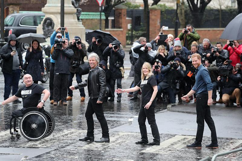 Prince Harry, Jon Bon Jovi and two Invictus Games choir members pose for a photo on the iconic Abbey Road crossing.