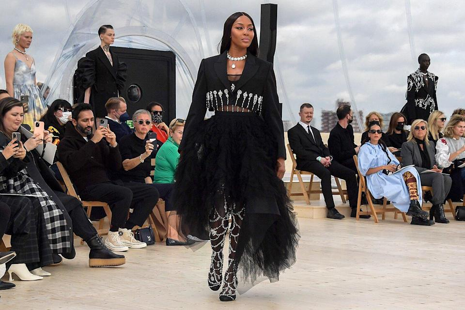 Naomi Campbell walks the runway at the Alexander McQueen SS22 Womenswear show at Tobacco Dock on October 12, 2021