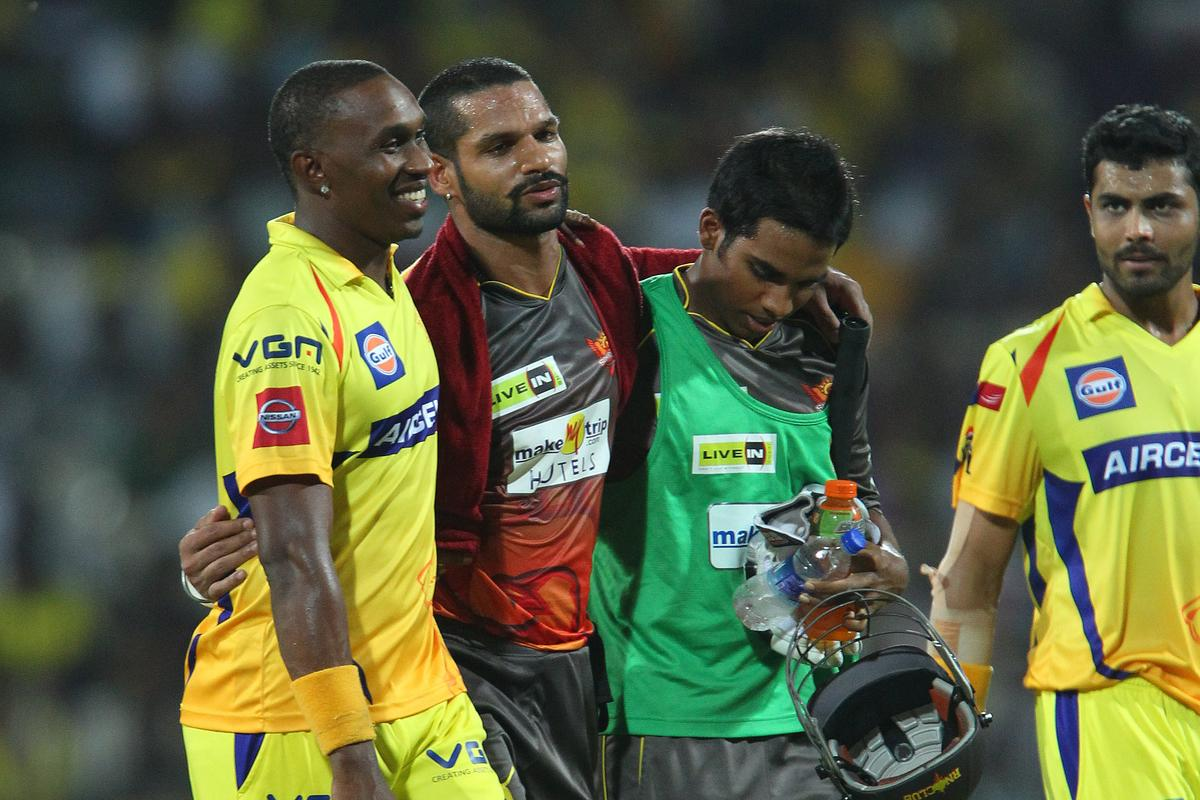 Dwayne Bravo walks with Shikhar Dhawan as he leaves the field after being hit by a delivery from Dwayne Bravo during match 34 of the Pepsi Indian Premier League between The Chennai Superkings and the Sunrisers Hyderabad held at the MA Chidambaram Stadiumin Chennai on the 25th April 2013. (BCCI)