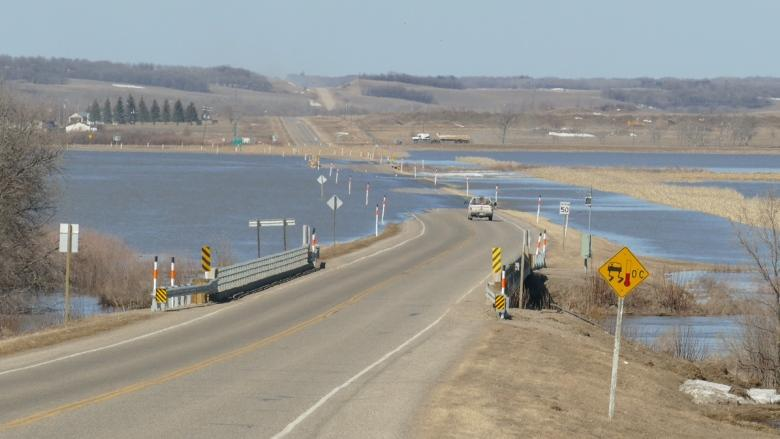 Sioux Valley watching Assiniboine River as Highway 21 washes out