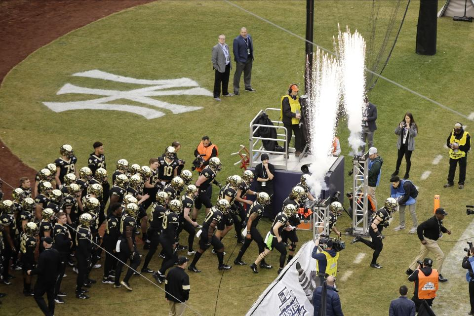 Wake Forest players run onto the field for the Pinstripe Bowl NCAA football game against Michigan State, Friday, Dec. 27, 2019, in New York. (AP Photo/Frank Franklin II)