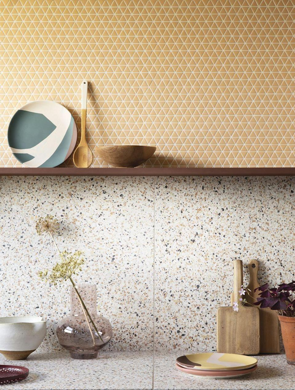 """<p>New tiles can make a huge difference. As well as thinking about colour and pattern, be creative about where and how you place them. Consider adding a contrasting style above a display shelf or making a <a href=""""https://www.housebeautiful.com/uk/house-beautiful-collections/g34526670/kitchen-glass-splashbacks-range/"""" rel=""""nofollow noopener"""" target=""""_blank"""" data-ylk=""""slk:feature splashback"""" class=""""link rapid-noclick-resp"""">feature splashback</a> with decorative designs.</p><p>Pictured: Confiserie recycled glass mosaic tiles in Sorbet; shelf painted in Brown eggshell; Trousdale Aniston Terrazzo tiles, all <a href=""""https://www.claybrookstudio.co.uk/"""" rel=""""nofollow noopener"""" target=""""_blank"""" data-ylk=""""slk:Claybrook"""" class=""""link rapid-noclick-resp"""">Claybrook</a></p>"""