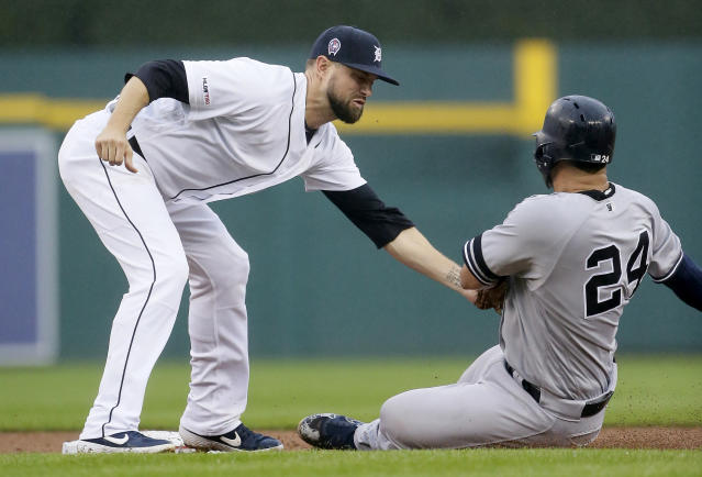 New York Yankees' Gary Sanchez (24) is tagged out by Detroit Tigers' Jordy Mercer trying to steal second base during the third inning of the second game of a baseball doubleheader Thursday, Sept. 12, 2019, in Detroit. (AP Photo/Duane Burleson)