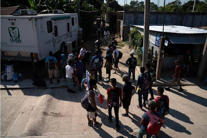 More than 50 migrants, 49 Honduran and one Guatemalan, walk to the nearest train station near Palenque, Chiapas, on Oct. 26. The group will be heading north by traveling on freight trains through México. They decided to travel as a group to be better protected from thieves, police, and Mexican immigration officers.