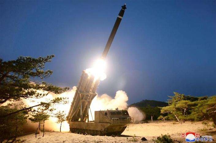 """North Korea says it successfully tested """"super-large multiple rocket launchers"""" on March 29, 2020 (AFP Photo/STR)"""