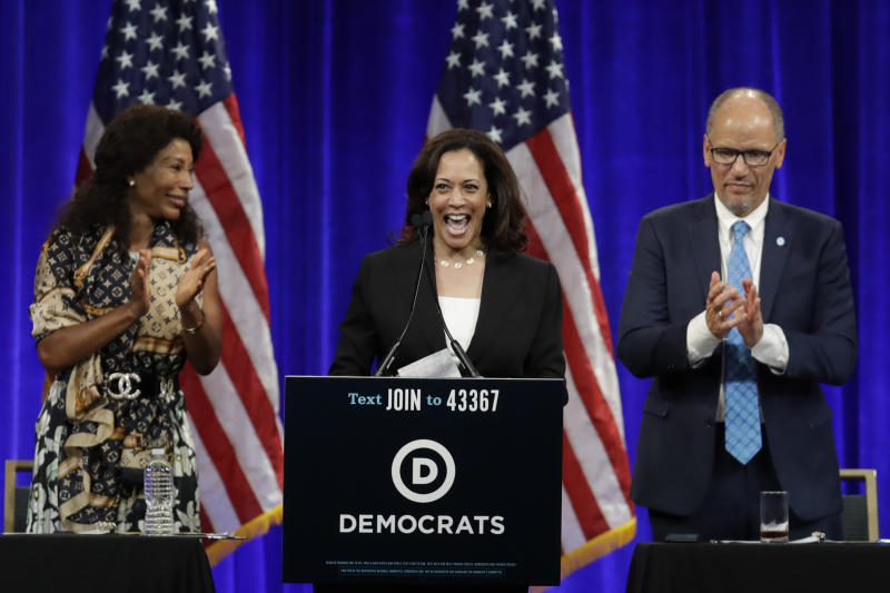 Democratic presidential candidate Sen. Kamala Harris, D-Calif., smiles as she is introduced at the Democratic National Committee's summer meeting Friday, Aug. 23, 2019, in San Francisco. More than a dozen Democratic presidential hopefuls are making their way to California to curry favor with national party activists from around country. Democratic National Committee members will hear Friday from top contenders, including Elizabeth Warren, Kamala Harris and Bernie Sanders. (AP Photo/Ben Margot)