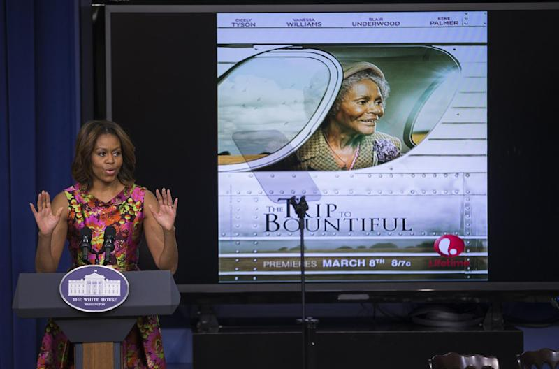 "First lady Michelle Obama gestures during remarks after a screening of the movie ""The Trip to Bountiful"" in the South Court Auditorium on the White House complex on Monday, Feb. 24, 2014, in Washington. (AP Photo/ Evan Vucci)"