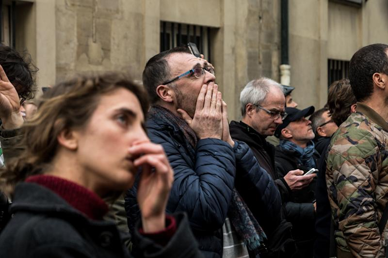 People watch the landmark Notre-Dame Cathedral burning in central Paris on April 15, 2019. (Photo: Nicolas Liponne/NurPhoto via Getty Images)