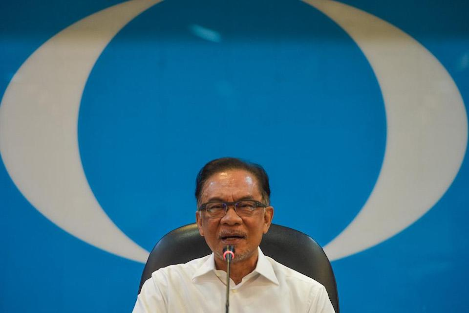 PKR President Datuk Seri Anwar Ibrahim signed the agreement along with Amanah and DAP's leaders. —Picture  by Miera Zulyana