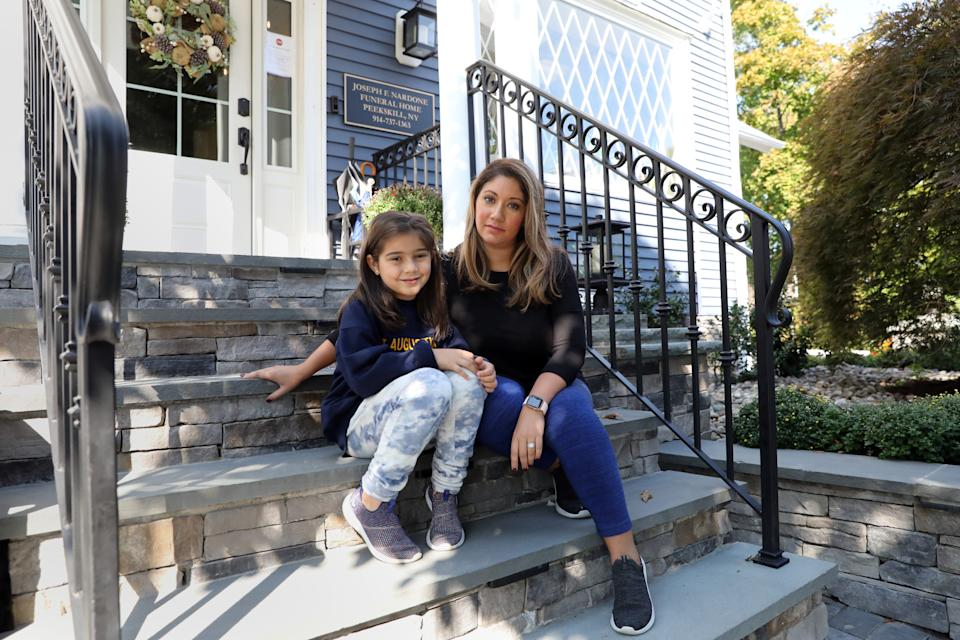 Leslie Chiaramonte and her 6 year-old daughter Brooklyn, who is on hybrid school schedule, sit outside the funeral home family business Oct. 7, 2020 in Peekskill. Chiaramonte was a nurse case manager at White Plains Hospital who had to quit last month to watch after her daughters. She also has a three-year-old.