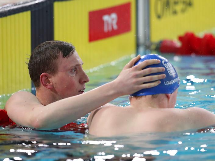 Swimmer Max Litchfield consoles his brother Joe