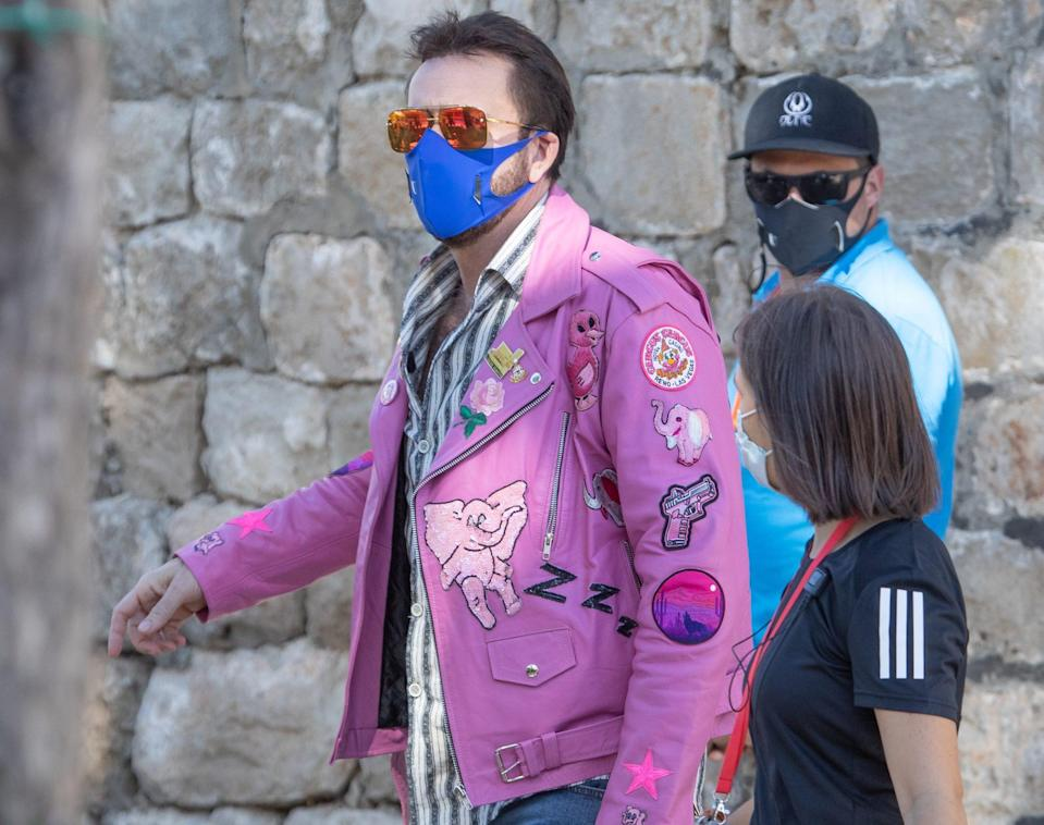 <p>Nicolas Cage wears a funky lilac jacket on the set of <em>The Unbearable Weight of Massive Talent</em> on Thursday in the village of Cavtat, Croatia.</p>