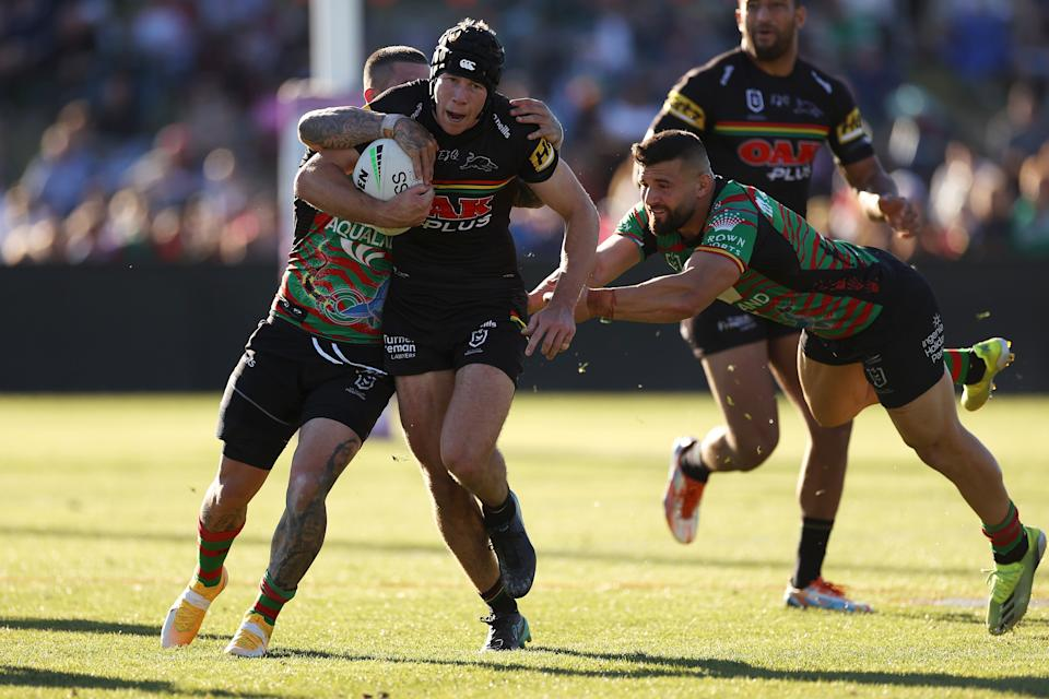 Matt Burton (pictured) is tackled during the round 11 NRL match between the South Sydney Rabbitohs and the Penrith Panthers.