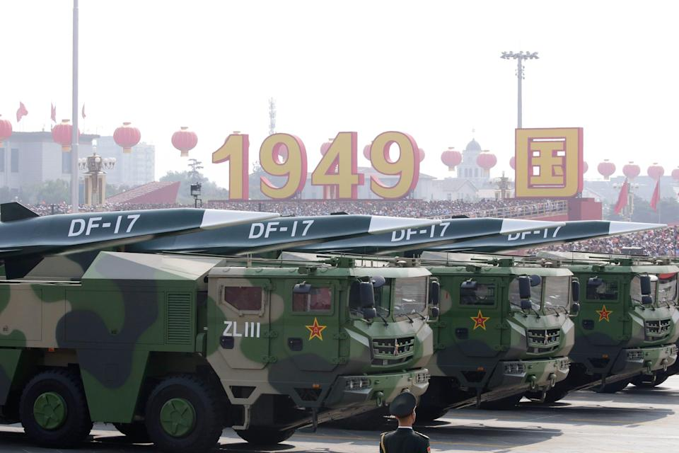 Military vehicles carrying hypersonic missiles DF-17 travel past Tiananmen Square during the military parade marking the 70th founding anniversary of People's Republic of China