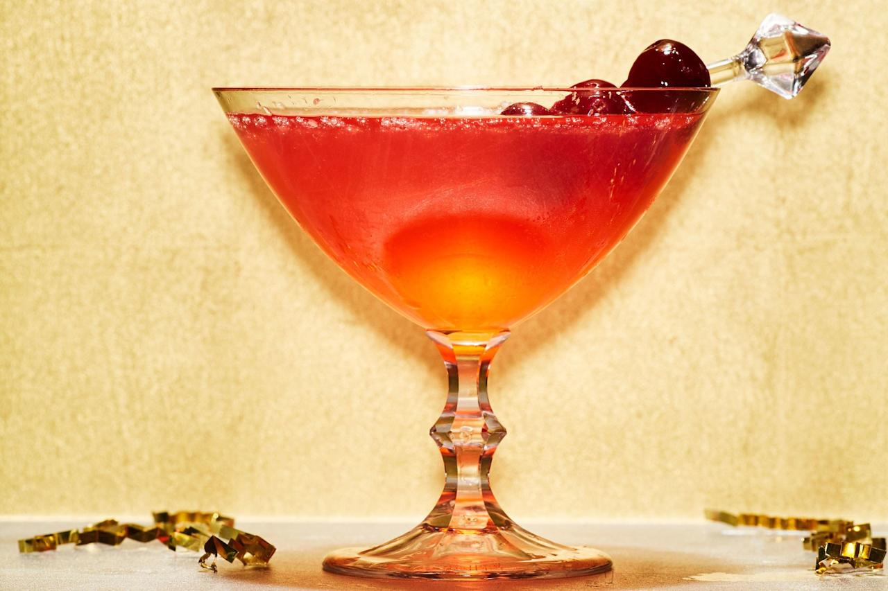 """A homemade cranberry simple syrup puts this sparkling cocktail recipe into fancy party-worthy status. Use leftover Campari to make your very own Negroni or Americano. <a rel=""""nofollow"""" href=""""https://www.epicurious.com/recipes/food/views/cran-royale?mbid=synd_yahoo_rss"""">See recipe.</a>"""