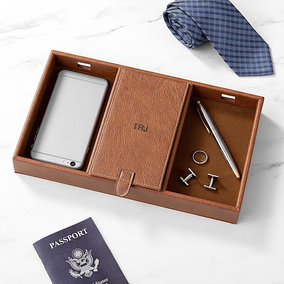 """<h3>Cathy's Concept Personalized Valet Charging Station</h3><br>Personalization is free on this sleek, vegan leather organization system. <br><br><em>Shop </em><a href=""""https://www.walmart.com/tp/cathy-s-concepts"""" rel=""""nofollow noopener"""" target=""""_blank"""" data-ylk=""""slk:Cathy's Concept"""" class=""""link rapid-noclick-resp""""><strong><em>Cathy's Concept</em></strong></a><br><br><strong>Cathy's Concept</strong> Personalized Valet Charging Station, $, available at <a href=""""https://go.skimresources.com/?id=30283X879131&url=https%3A%2F%2Fwww.walmart.com%2Fip%2FPersonalized-Men-s-Valet-Charging-Station%2F783893941"""" rel=""""nofollow noopener"""" target=""""_blank"""" data-ylk=""""slk:Walmart"""" class=""""link rapid-noclick-resp"""">Walmart</a>"""