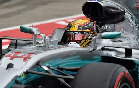 Mercedes' British driver Lewis Hamilton drives in the pit lane during the qualifying session of the Formula One Japanese Grand Prix at Suzuka on October 7, 2017. REUTERS/Kazuhiro Nogi/Pool