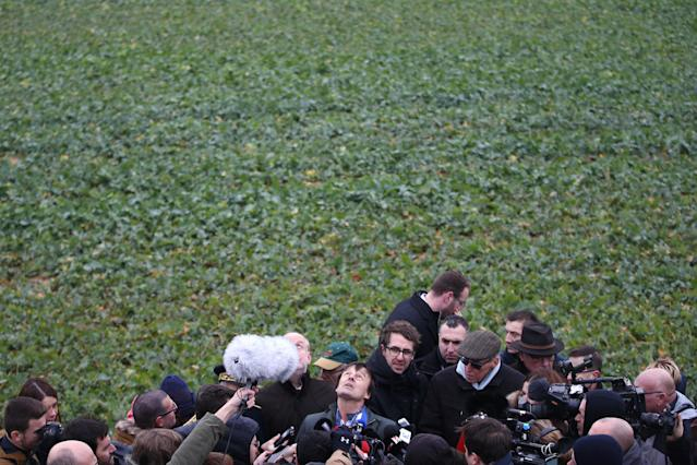 French Minister for Ecological and Inclusive Transition Nicolas Hulot is surrounded by journalists as he attends a visit at a wind farm in Juille near Le Mans, France January 8, 2018. REUTERS/Stephane Mahe