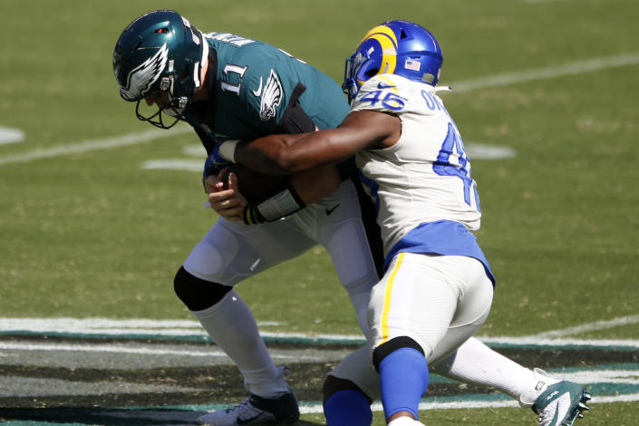 Carson Wentz and the Eagles are 0-2 after a loss to the Rams. (AP Photo/Laurence Kesterson)