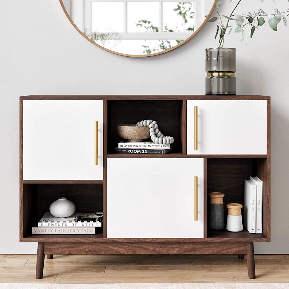<p>This <span>Nathan James Ellipse Modern Multipurpose Display Credenza</span> ($141) is so practical and spacious.</p>