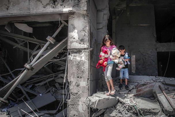 PHOTO: Palestinian children salvage toys from their home at the Al-Jawhara Tower in Gaza City, May 17, 2021, which was heavily damaged in Israeli airstrikes.  (AFP via Getty Images)