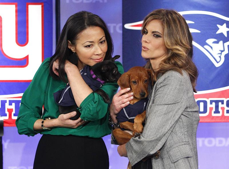 "This Feb. 1, 2012 photo released by NBC shows co-hosts Ann Curry, left, and the Natalie Morales holding puppies just before a puppy bowl segment on the ""Today"" shows in New York. Curry offered a tearful goodbye as co-host of NBC's ""Today"" show on Thursday, June 28, 2012. Curry, who joined the show as a news anchor in 1997, will remain at NBC News to be anchor-at-large and national and international correspondent. (AP Photo/NBC, Peter Kramer)"