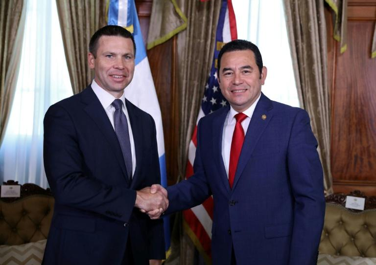 US acting Secretary of Homeland Security Kevin McAleenan (L) shakes hands with Guatemalan President Jimmy Morales at the Culture Palace in Guatemala City on August 1, 2019
