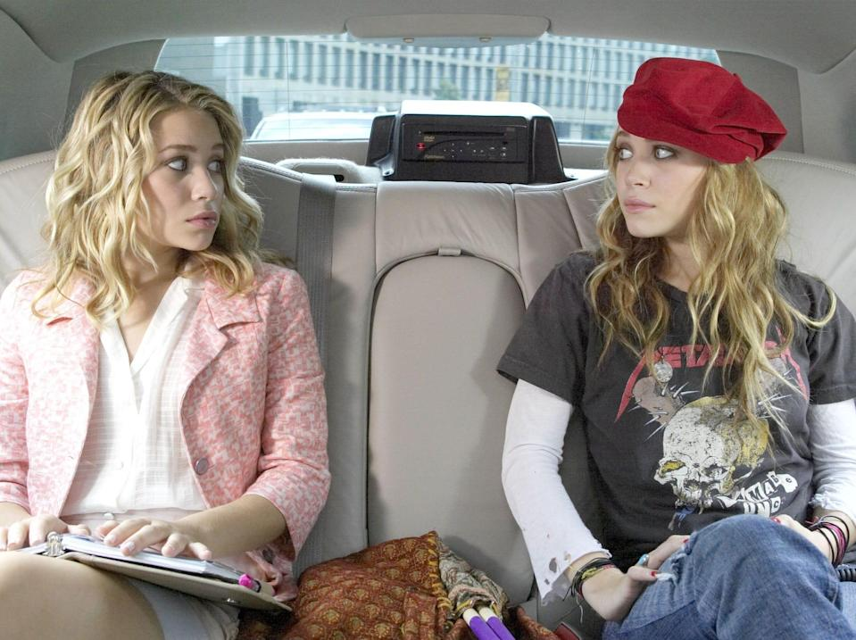 Mary-Kate and Ashley Olsen in a car