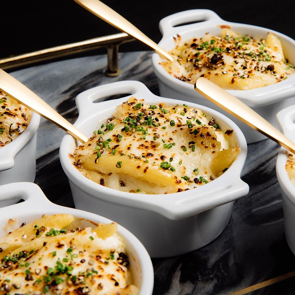"""<p><strong>Wolfgang Puck Catering</strong></p><p>goldbelly.com</p><p><strong>$119.00</strong></p><p><a href=""""https://go.redirectingat.com?id=74968X1596630&url=https%3A%2F%2Fwww.goldbelly.com%2Fwolfgang-puck-catering%2Fcacio-e-pepe-mac-and-cheese-combo-for-4&sref=https%3A%2F%2Fwww.townandcountrymag.com%2Fleisure%2Fdining%2Fg23937264%2Fgourmet-food-gifts%2F"""" rel=""""nofollow noopener"""" target=""""_blank"""" data-ylk=""""slk:Shop Now"""" class=""""link rapid-noclick-resp"""">Shop Now</a></p><p>Give their comfort food and upgrade with this selection of indulgent cacio e pepe macaroni and cheese and truffle macaroni and cheese from Wolfgang Puck. Both are made with housemade cavatappi pasta and lush cheeses that make for an irresistible treat. </p>"""