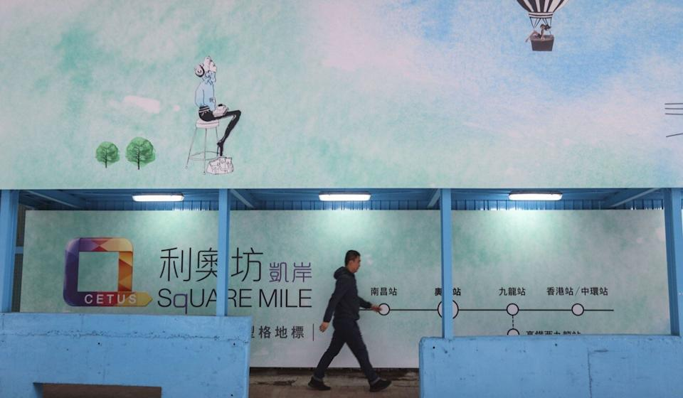 A passer-by walks in front of a Henderson Land Development project in Mong Kok in 2018. Photo: Felix Wong