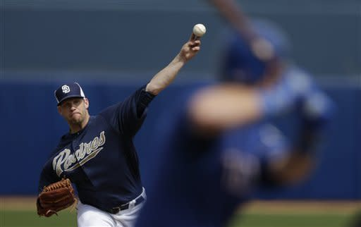 San Diego Padres starting pitcher Eric Stults, left, throws to Texas Rangers' Mike Olt during the second inning in an exhibition spring training baseball game on Saturday, March 9, 2013, in Peoria, Ariz. (AP Photo/Gregory Bull)