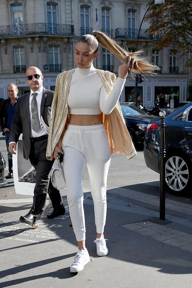 <p>Continued: <em>The Audacity of Fleece in Paris</em>, which is what Gigi Hadid should title her memoirs. Here, as an athleisure angel in all white, she sends a message of comfort and joy and taking pride in the quintessentially American trait of DGAF-ness. </p>