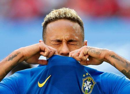 Brazil's Neymar looks dejected after missing a chance to score. REUTERS/Carlos Garcia Rawlins