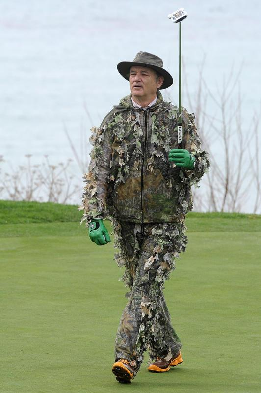 """Perhaps in a nod to Carl Spackler, who wore camo on the course in """"Caddyshack,"""" Murray went head to toe with the pattern as if he were going hunting, not golfing."""