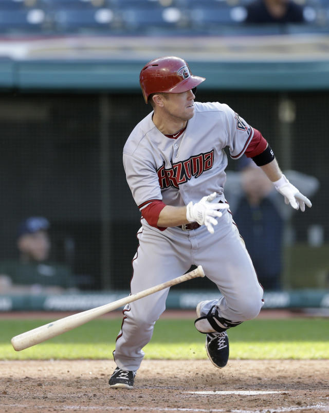 Arizona Diamondbacks' Aaron Hill runs out a ground ball hit off Cleveland Indians starting pitcher Trevor Bauer in the seventh inning of the first baseball game of a doubleheader, Wednesday, Aug. 13, 2014, in Cleveland. Hill was out on the play. Mark Trumbo scored on the play. (AP Photo/Tony Dejak)