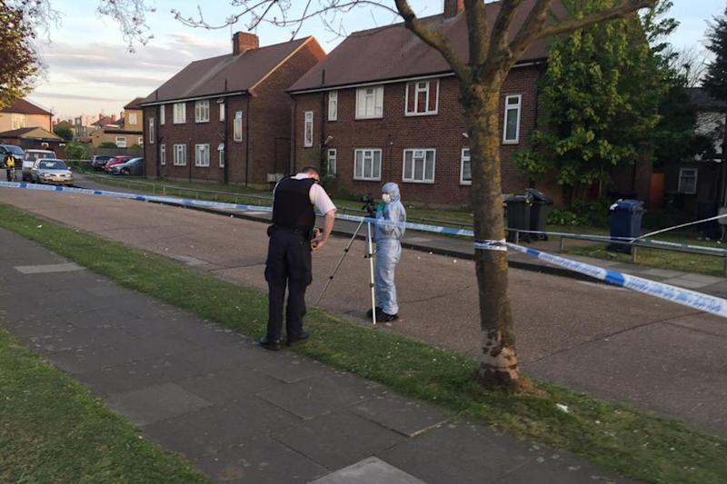 Police investigation: Forensic officers at the scene of a fatal stabbing in Northolt (Daniel O'Mahony)