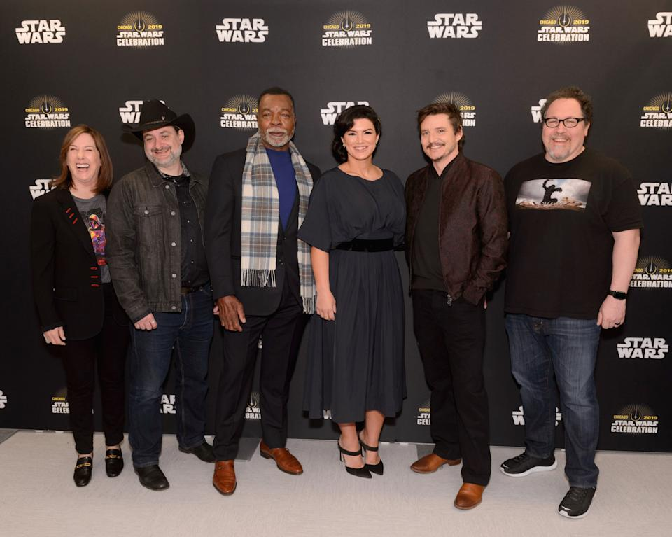"""CHICAGO, IL - APRIL 14:  (L-R) Executive producer Kathleen Kennedy, Director/executive producer Dave Filoni, Carl Weathers (Greef), Gina Carano (Cara Dune), Pedro Pascal (The Mandalorian) and Director/executive producer Dave Filoni attend """"The Mandalorian"""" panel at the Star Wars Celebration at McCormick Place Convention Center on April 14, 2019 in Chicago, Illinois.  (Photo by Daniel Boczarski/WireImage for Disney)"""