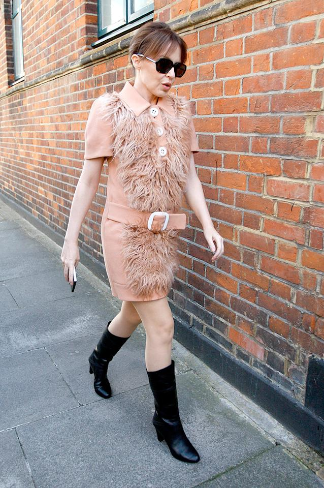 "We absolutely adore Kylie Minogue, but we happen to abhor the mangy Prada frock the ""Love at First Sight"" songstress wore on Thursday en route to a business meeting in London. (10/20/11)"