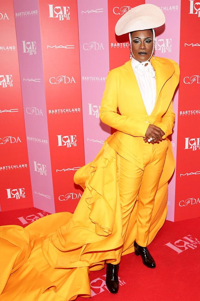 <p>The actor wore a sunshine yellow Francis Libiran suit with a massive train, white Esenshel hat, white blouse, and black leather boots. </p>